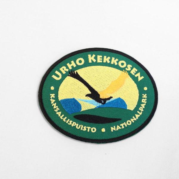 Kangasmerkki Urho Kekkosen kansallispuisto. Logossa kotka.