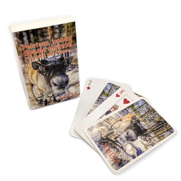 Pelikortti pakkaus sekä esimerkki kortit, joissa poro